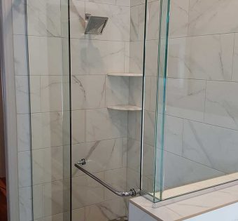 Stainless Steel Trimmed Frameless Shower Enclosure