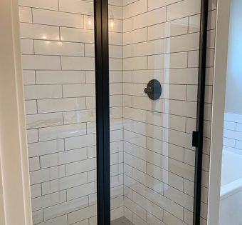 Black Semi-frameless Shower with White Tile